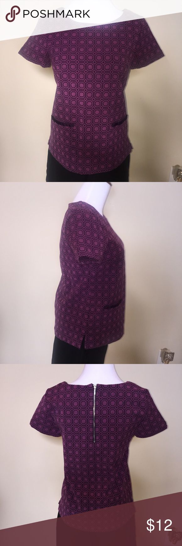 Short sleeve geometric pattern top Structured, stretchable short sleeve top. Purple with geometric pattern in front/back. Two small pockets on front and silver zipper on back. Nice summer shirt for the office. Size XS. New York & Company Tops
