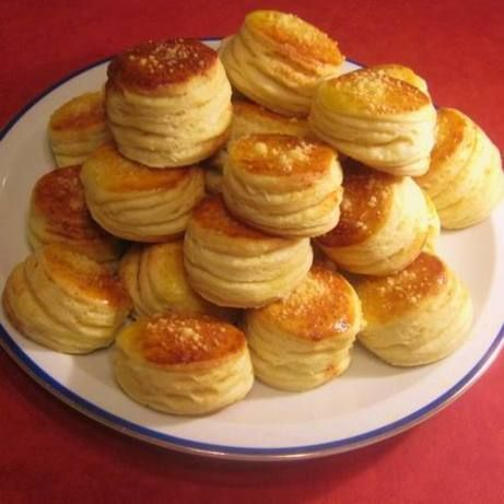 These pogacsa, Hungarian for biscuit, are perfect for parties. You may either add the following in the dough, sprinkled on top before baking, or both - finely shredded medium-firm fresh cheeses and aged dry hard cheeses, chopped pork crackling, minced cabbage, black pepper, hot or sweet paprika, minced garlic, minced red onion, caraway seeds, sesame seeds, sunflower seeds or poppy seeds.