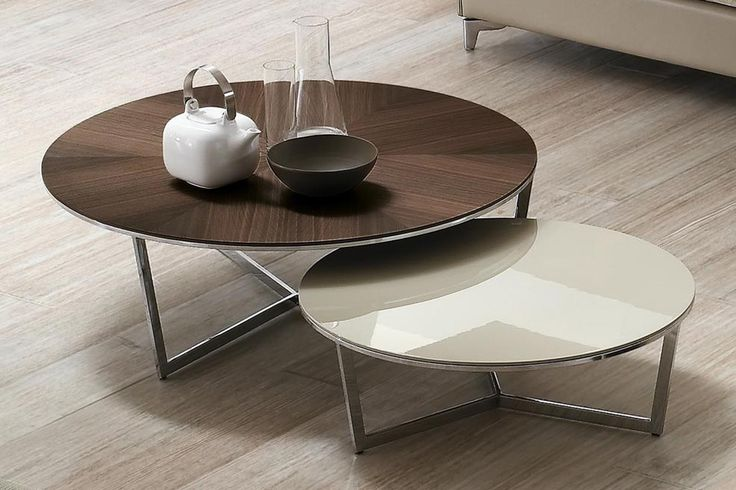 Designer   Giuseppe Bavuso   Harpa Coffee table with Chrome-plated or painted steel base. Top available in: white acrylic stone, marble, oak, ebony or lacquered MDF.
