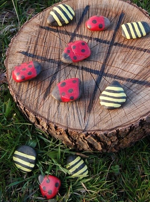 lady bug tic-tac-toe, use sharpie markers if you don't have paint ,just make sure is light coloured stone for bee so that the yellow  will show.