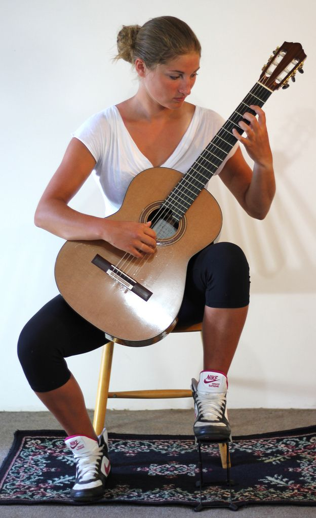 Sitting position for classical guitar: with foot stool: http://www.thisisclassicalguitar.com/basic-posture-and-sitting-position-guitar/  #guitar #classicalguitar