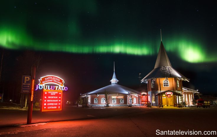 Santa Claus Holiday Village in Rovaniemi in Lapland in October under Northern lights