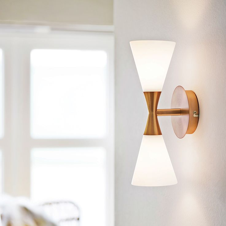 """Harlekin Duo mid century wall lamp, Denmark.  Opal glass with copper option.  12.6"""" high X 4"""" diameter.  78"""" cord for pin up mount, or can be direct wired. Takes 2 E14 standard candelabra base bulbs.  List $143."""