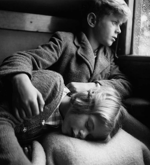 +~+~ Antique Photograph ~+~+  Tender photograph of a brother holding his sister while she sleeps on the train. By photographer Ata Kando`.