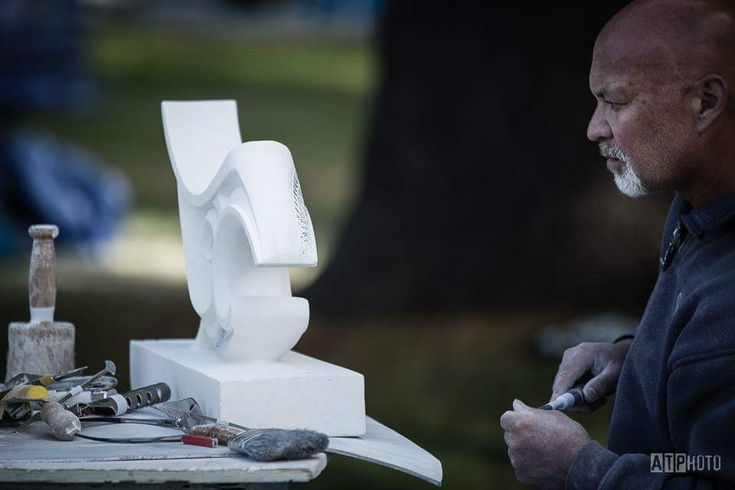 Brett working on one of his sculptures at the annual Maidstone Park Symposium.
