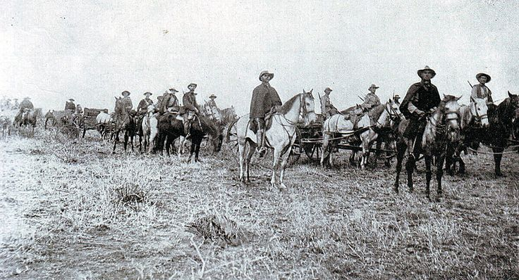 Boers with a Maxim machine gun on a carriage during the Boer War