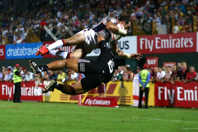 Zack Test of the United States, top, being tackled by New Zealand's Augustine Pulu during a World Sevens Series match in Dubai in December...