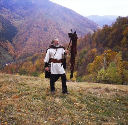 dacian man with dacian draco wolf fight symbol carpathians mountains