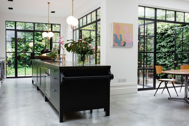 Modern Kitchen of The still-life photographer and newspaper and magazine editor open the doors to their London home.