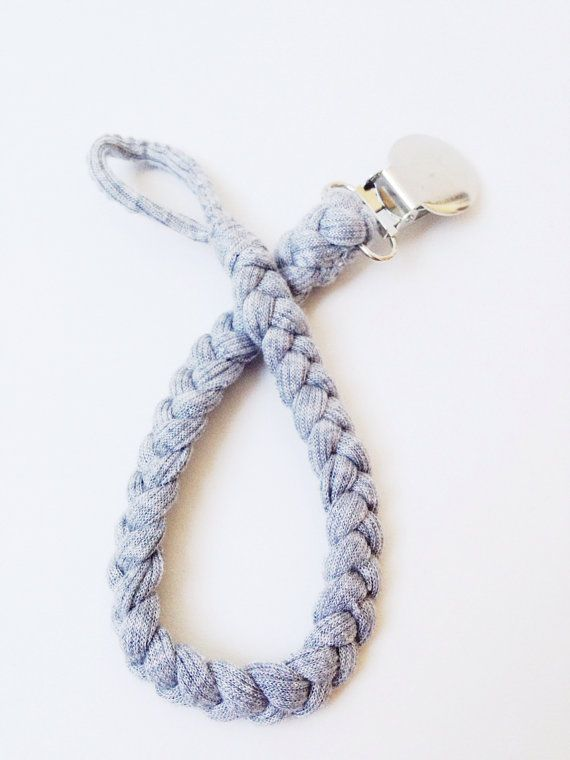 Wonderful Pacifier clip. Made of stretchy ribbed jersey. Goes with every outfit. Very neutral, and sophisticated. Hooray for no silly baby patterns!