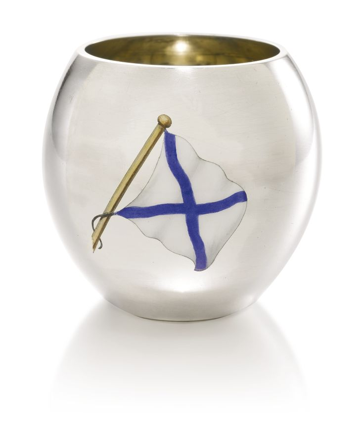A FABERGÉ SILVER AND ENAMEL VODKA CUP, FIRST SILVER ARTEL, ST PETERSBURG, 1908-1917 enamelled en plein with the Russian Imperial naval ensign, gilt interior, struck with maker's mark and Fabergé in Cyrillic beneath the Imperial Warrant, 88 standard, scratched inventory number 19514