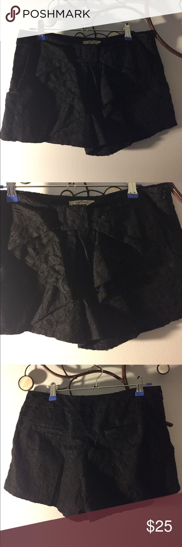 Black Lace shorts with bow Black lace shorts,lining no stretch with bow stitched on front of shorts. No trades. Pair with a wife beater or crop top. Alythea Shorts Bermudas