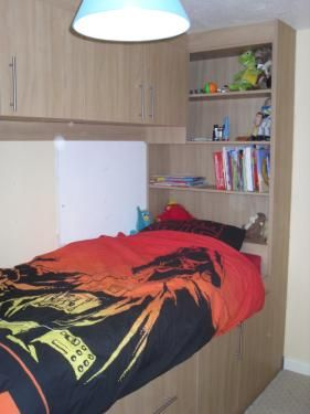 bedroom over stairs | Cabin bedroom, bed built over a stairs bulkhead thereby disguising the ...