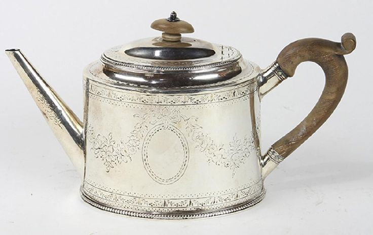 """Hester Bateman -  George III sterling silver teapot. Asking $2,750. Offers accepted. London 1781, having an oval form with carved wood finial and handle with hinged lid, 5.5""""h x 10""""w x 3.5""""d, approximately 12.5 troy oz."""