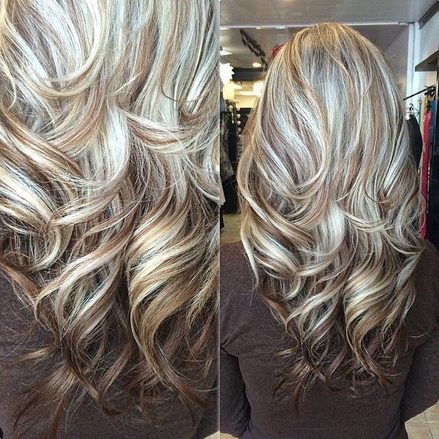 long layered haircut in light blonde highlights with brown lowlights