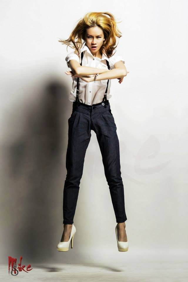 Sapphire Ng jump shot, rocking an androgynous look of super cool pants and classy translucent