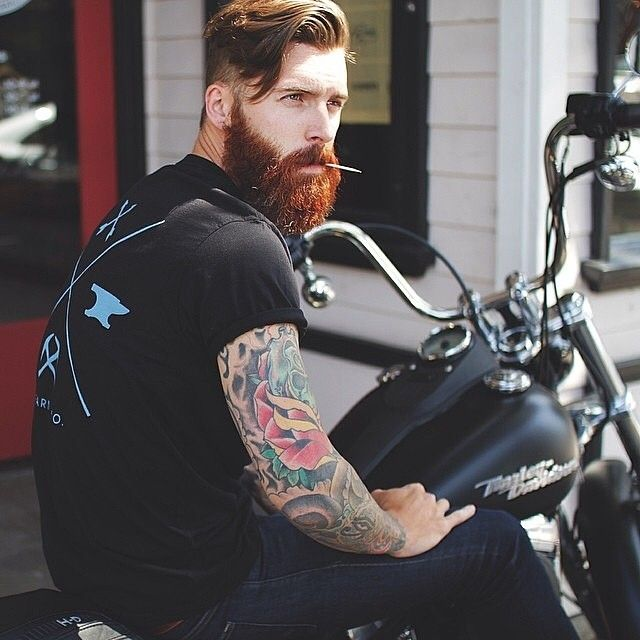 verymanlyman:  beardstofuck:  OH MY GLOB YES!!! red beard, tattoos, and a bike uggggh I love this.  Levi Stocke