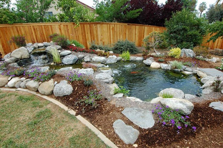 How to build small waterfalls small backyard landscaping for Cool backyard ponds