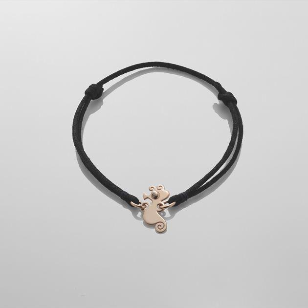 Bracciale  piccolo cavalluccio  in oro rosa 9 Kt occhi con diamante e cordino nero a scorsoio