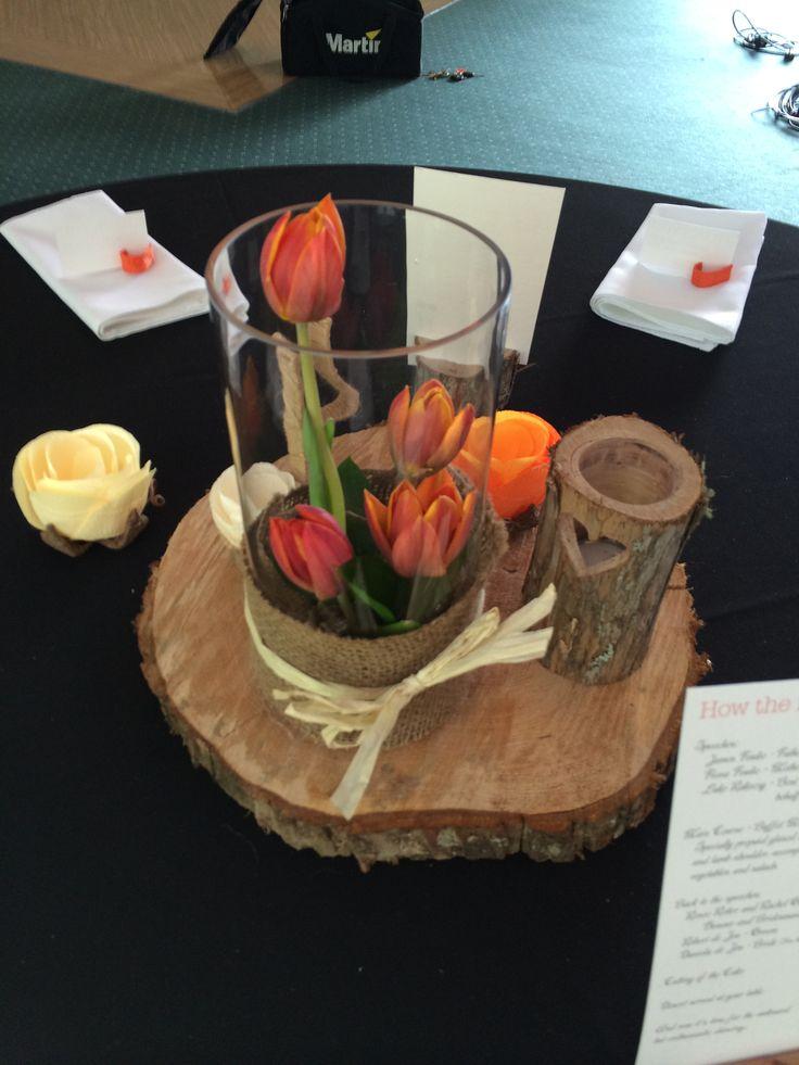 Orange tulips in tall circular vase with hessian wrap and raffia bow created by Florist ilene.