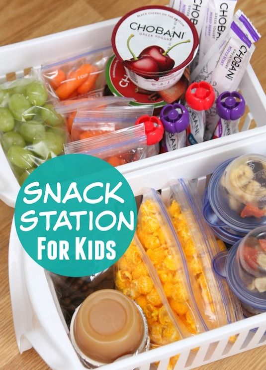 #6. Create an easy to access snack station for the kids using pull-out plastic bins. | 11 Brilliant Fridge Organization Ideas