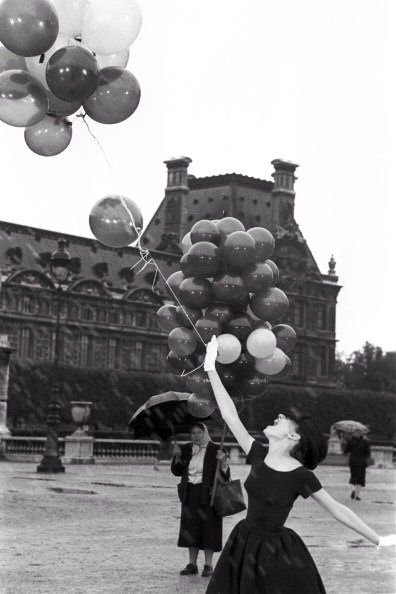Audrey Hepburn with Richard Avedon on the set of Funny Face in Paris, France, 1956.