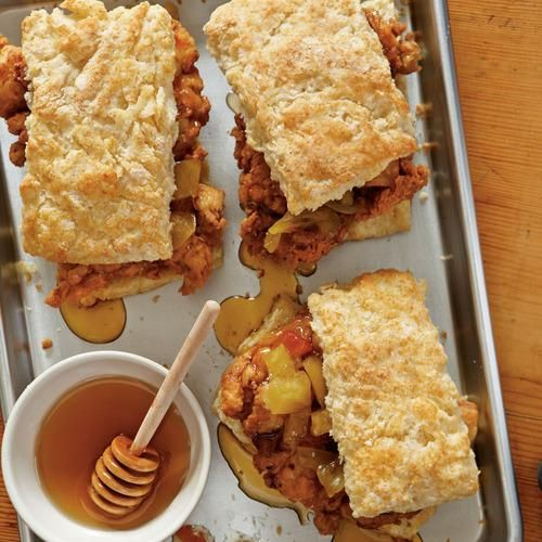Fried Chicken Thighs and Biscuits Two Southern icons make the ultimate sandwich, generously topped with pickled green tomatoes and local honey.