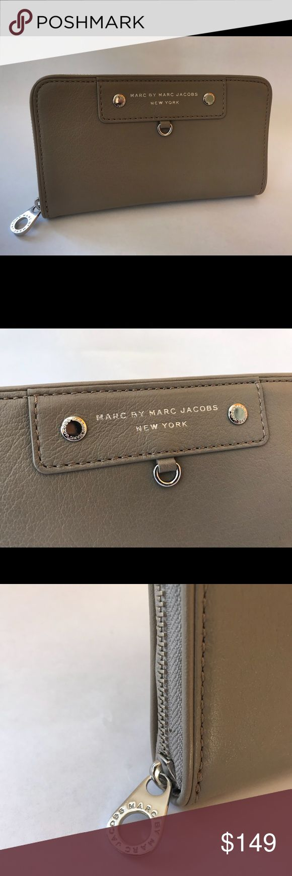 "Marc by Marc Jacobs Grey Zip Around Wallet Grey Marc by Marc Jacobs zip around wallet. Unused with original tag.   - Marc by Marc Jacobs saffiano leather organizer wallet. - Zip-around closure with metal pull. - Interior, one zip section; three open sections card holders. - Exterior, silver logo at top center. - 4.5""H x 8""W x 1""D.  Thanks for looking! Marc By Marc Jacobs Bags Wallets"