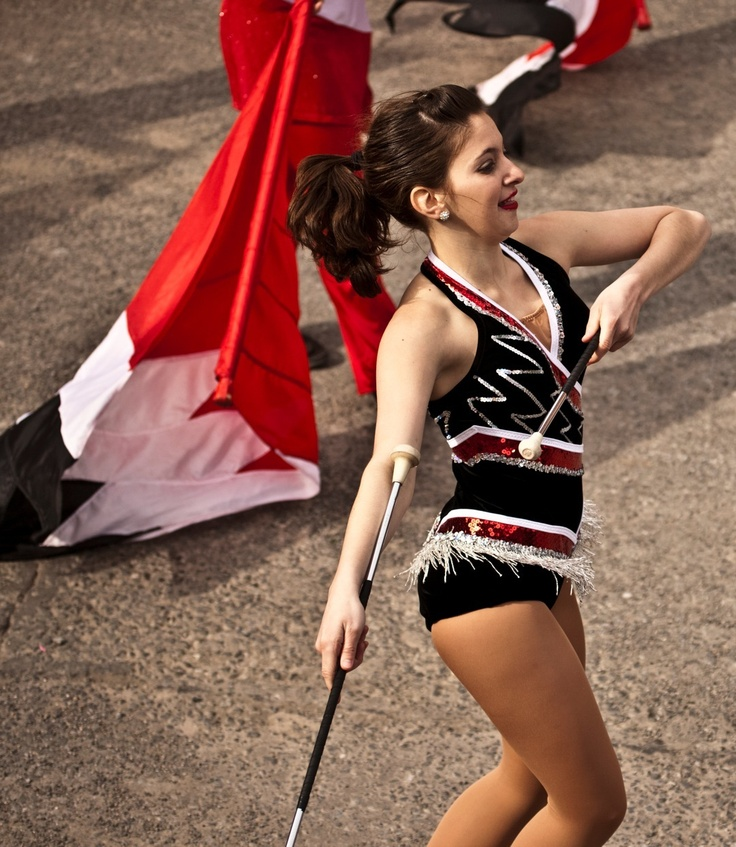 Twirler with the North Carolina State University Band, performing at a St. Patrick's Festival in Dublin.  Image by William Murphy.