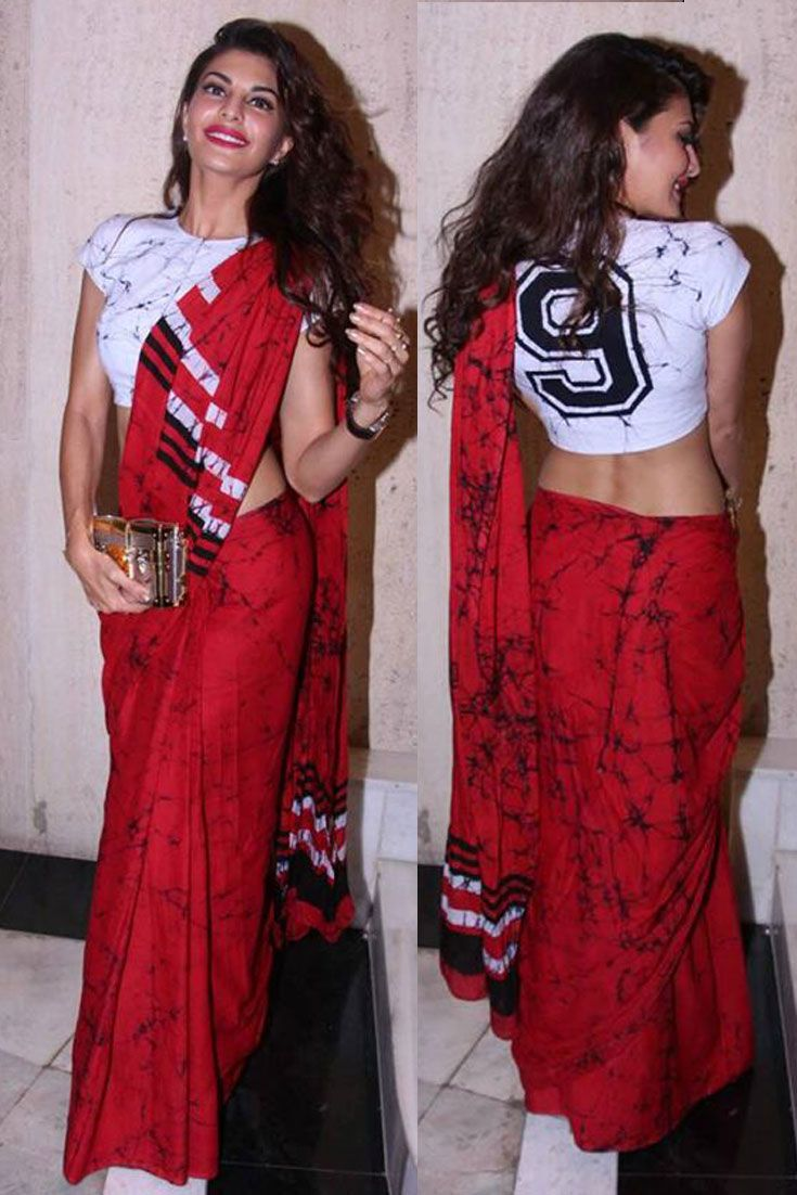 Bollywood Diva Jacqueline Fernandez sporting a red printed Saree with a t-shirt. We loved her casual avatar..