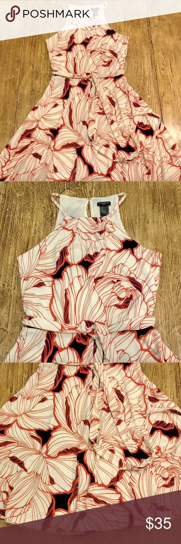 Ann Taylor Petite High Neck Halter Dress Floral This is a gorgeous Ann Taylor Petite women's high neck halter sleeveless dress in excellent used condition. Gorgeous orange cream and black floral print. Belt ties at the waist. Unlined except at the bust. Size XXSP. Overall in excellent condition perfect for the workplace or any occasion!  Measurements: Underarm to Underarm: 14.5 in. Full Length: 33 in. Waist: 28 in. Hips: 56 in. (full flared skirt) Ann Taylor Dresses