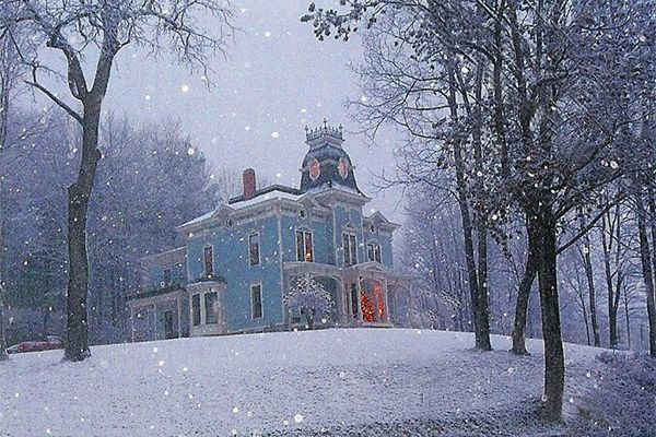 Perched high on a hill, this magical Victorian home for sale looks straight out of a holiday postcard.: