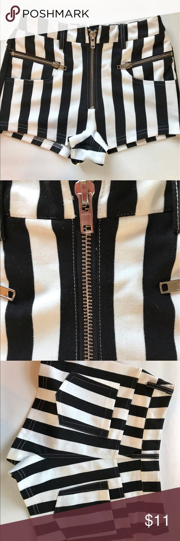 High waisted black and white stripes shorts Like new!!! Worn once. High wasted shorts. Striped black and white. Zip up front. Pockets in back. Stretchy material Shorts