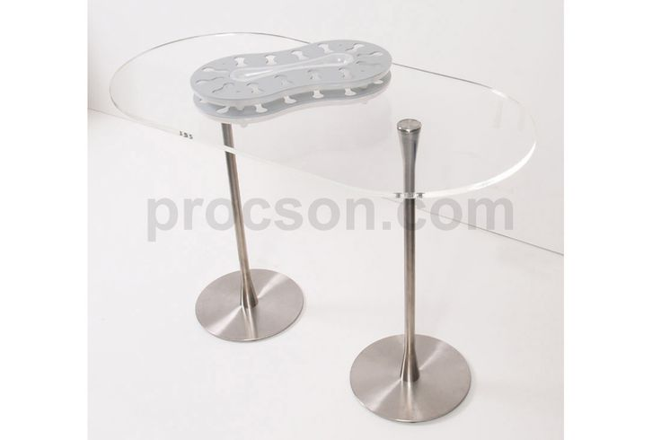 Arc Communion Table. We were asked several times to produce a communion table and Stephen wanted to design one which looked 'related' to the Arc. Therefore our communion table uses the same stem and base as the Arc Water table but has a top that is slightly larger than double the size. This helps to create a unified look for your church interior. It is shown in the photo with the Swirla Communion Trays.