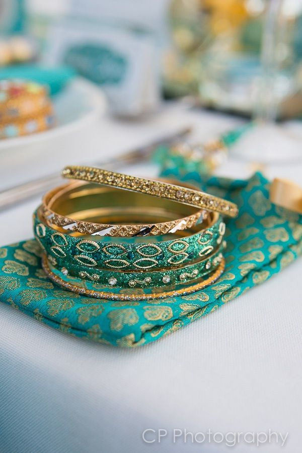 Agra Dreams bangles in sari pouch make great wedding favours in teal and gold by www.fuschiadesigns.co.uk.