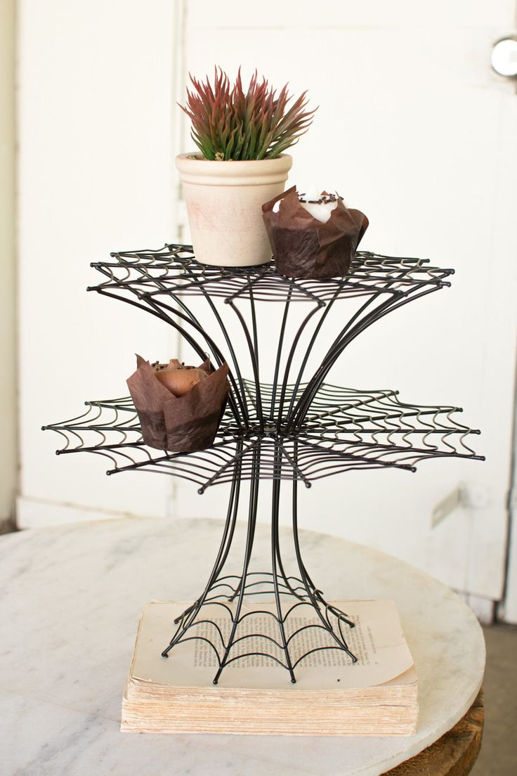 The Kalalou Two Tier Spider Web Display Stand is an epitome of creativity. The display stand in the look of a spider web is an innovative idea which is beautifu