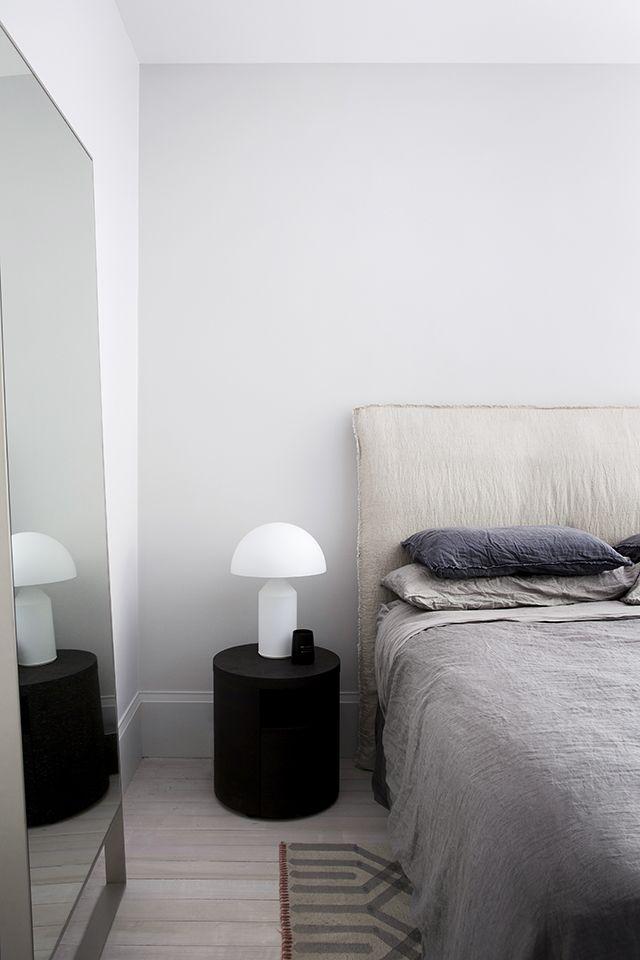 linen headboard + simple nightstand