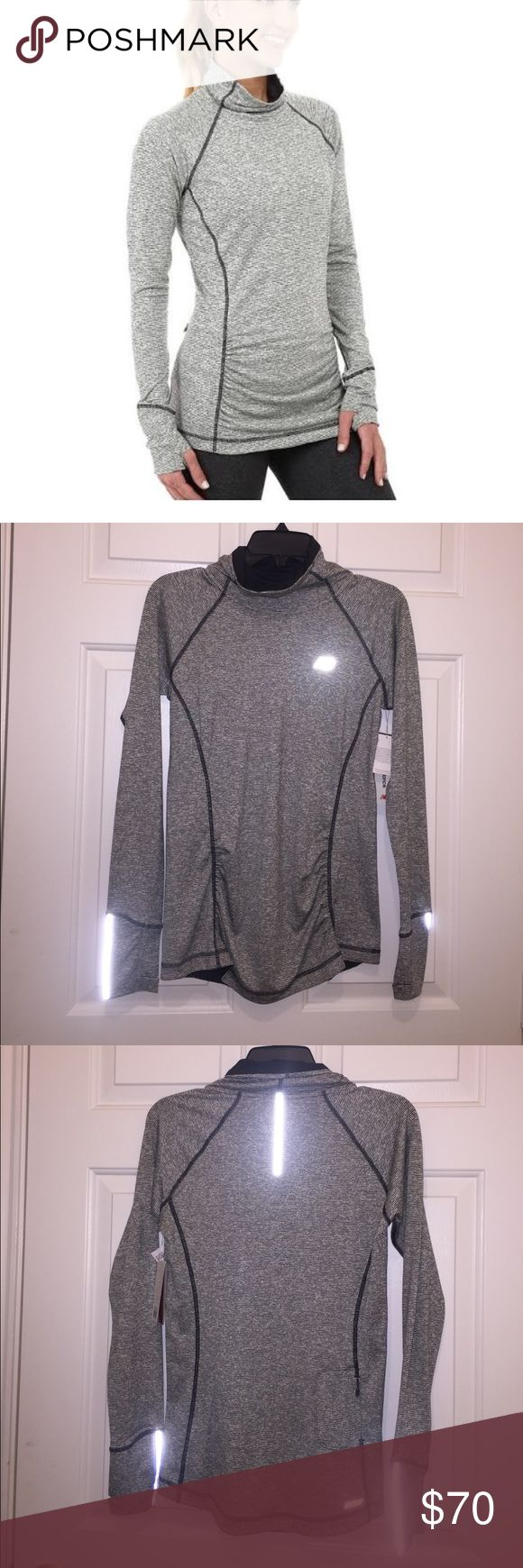 New Balance Glo Pullover Awesome athletic top, quick dry fabric, thumb holes, reflective, and zipper pocket on lower back. NWT. New Balance Tops
