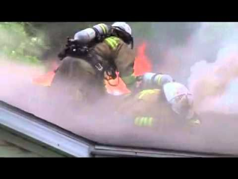 Firefighter close call. Fall through roof