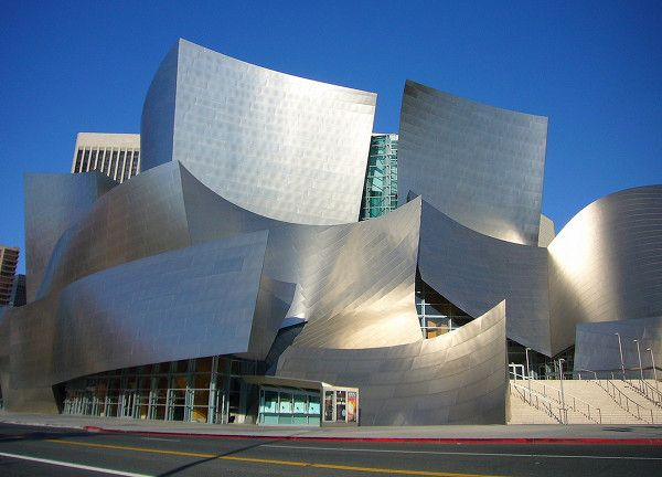 The  Walt Disney Concert Hall in downtown Los Angeles, looks anything but old-fashioned. The exuberant facade constructed from brushed stainless steel seems to swoop and burst and pop like fireworks. These panels seem to dance right out of the ground and into the sky, as though they were created by the music, not for the music.    The building, considered to be one of Gehry's most important, relates well to the city of Los Angeles where it occupies a full block near the Dorothy Chandler…