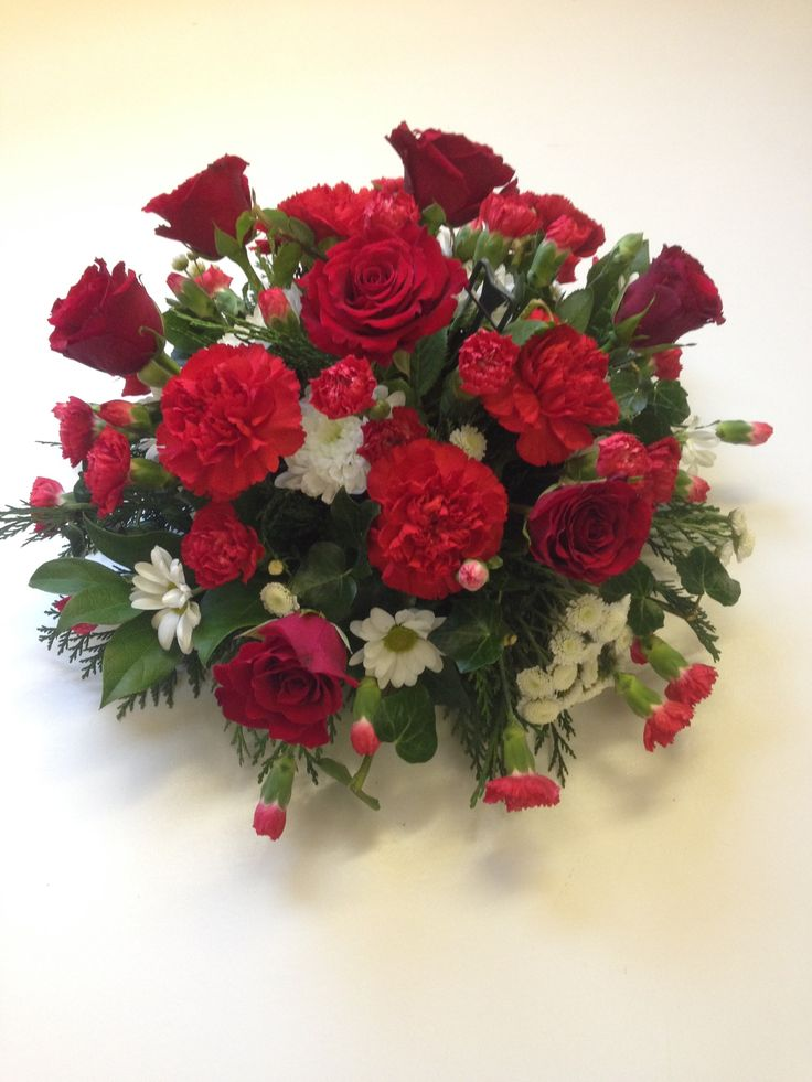 Red and white funeral posy with red roses