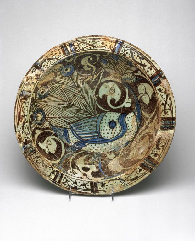 Bowl with Peacock Motif, ca. 1200–1230. Ceramic; fritware, painted in luster on a transparent glaze with touches of cobalt blue, 4 1/8 x 14 3/16 in. (10.5 x 36 cm). Brooklyn Museum, Gift of Mr. and Mrs. Carl L. Selden, 78.81. Creative Commons-BY (Photo: Brooklyn Museum, 78.81_SL1.jpg)