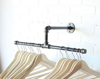 Concept: 50 inch Rustic Industrial double shelf clothing rack. Perfect for a den, entryway, laundry room, closet, or bedroom. This item does not ship internationally due to the length exceeding international shipping standards to most countries. Please check out some of my other clothing racks as they DO ship internationally. Specs: This piece is hand crafted and machined out of 1/2 inch black iron and galvanized steel. The frame can be custom painted to any color you wish, or just clear...