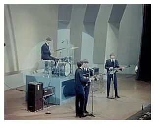 The Beatles performing at the Empire Theatre in Liverpool, 7 Dec. 1963