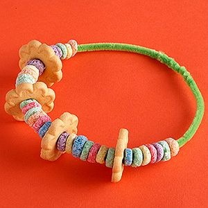 This DIY tropical lei is not only a fun craft for you and your kiddo, but it's edible! Talk about yummy!