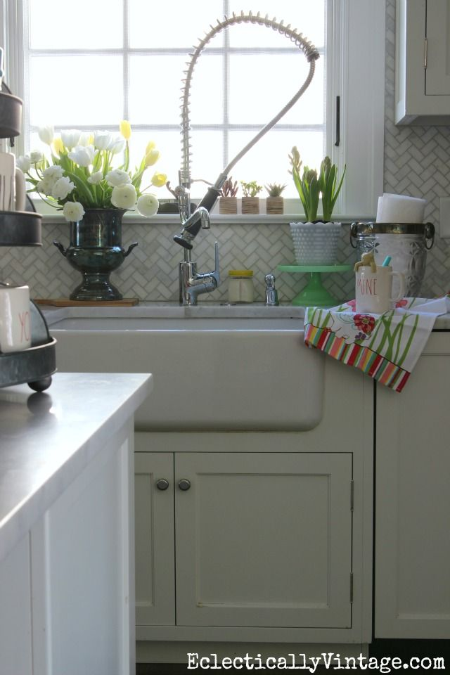 Make your kitchen sink a happy place with some fun (love the unique paper towel holder) and colorful accessories like the mug and dish towel from HomeGoods eclecticallyvintage.com sponsored pin