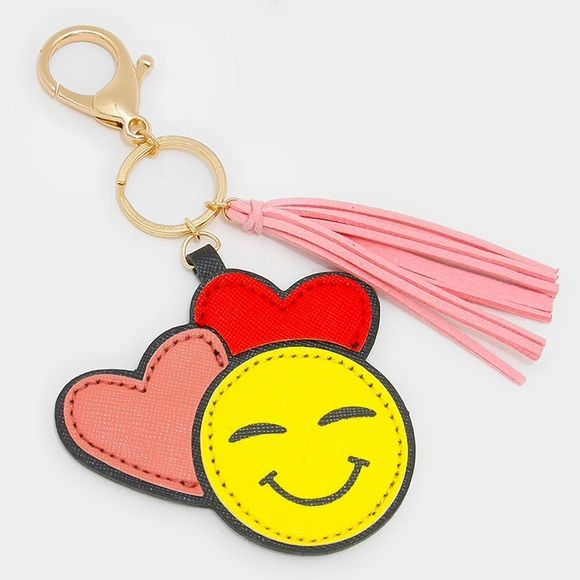 "Emoji (Double Heart) Key Chain • Style No : [302995]  • Color : Gold, Multi • Theme : Heart, Tassel  • Size : 3"" W, 5.5"" L • Double heart emoji key chain with faux suede tassel charm Accessories Key & Card Holders"