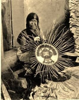 Hopi Indian woman circa 1920. The Hopi are a Native America Nation who primarily live on the 1.5 million acre Hopi Reservation in northeaster Arizona. The reservation is surrounded by the Navajo reservation. Hopis call themselves Hopitu - 'The Peaceful People'. (V)