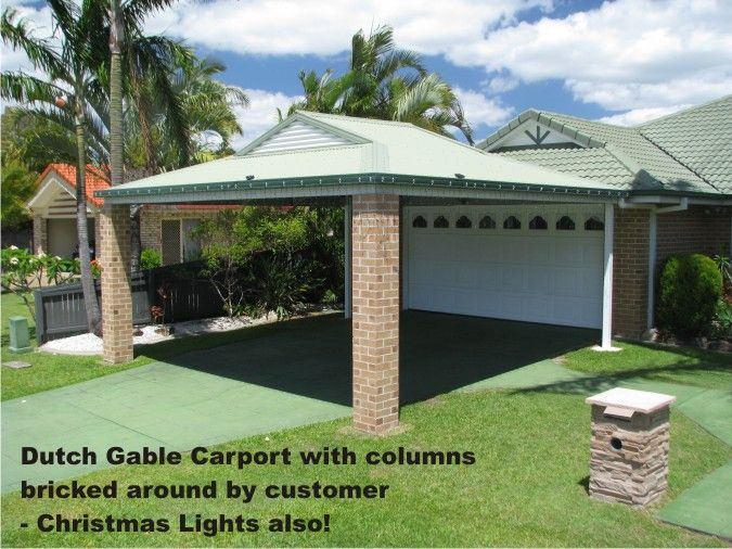 This Dutch Gable Carport was installed and then the owner simply had the 2 front posts bricked around to match the house.