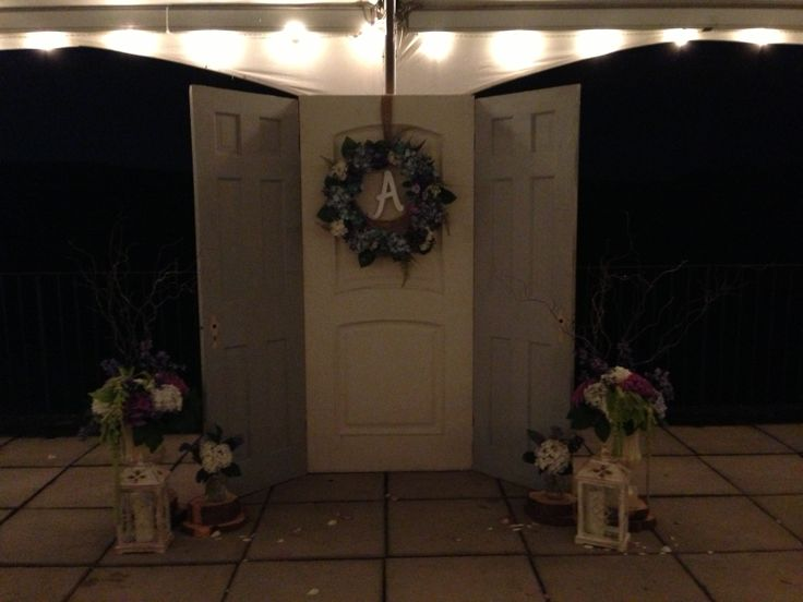 Backdrop to the ceremony, old recycled doors from a restoration store